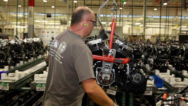 Gregg Trobentar works on the engine assembly line at the Harley-Davidson plant in Menomonee Falls.