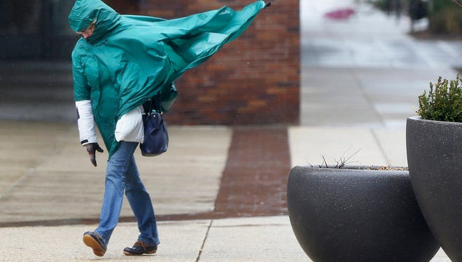 A woman struggles against wind and rain along the Benjamin Franklin Parkway in center city on Friday, March 2, 2018 in Philadelphia.