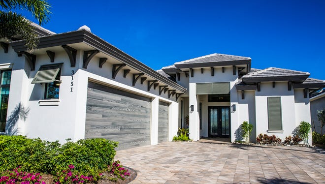 The Aviano, a three-bedroom, fully furnished luxury model home built by Harbourside Custom Homes, in the exclusive gated village of Marsh Cove within the Fiddler's Creek community.