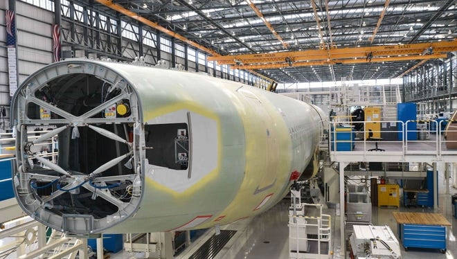In this file photo taken on September 13, 2015 the tail end of an Airbus A321 on the eve of the inauguration of Airbus' US manufacturing facility in Mobile, Alabama. The US trade deficit swelled in January to its largest level in nearly a decade as oil prices rose and the world's biggest economy sold fewer aircraft, government data showed on March 7, 2018. The news comes amid White House furor over trade policy, with President Donald Trump's top economic advisor Gary Cohn announcing his resignation late Tuesday after losing a bruising internal battle over whether to impose punishing tariffs on steel and aluminum.