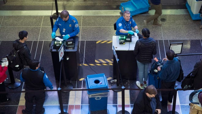 Transportation Security Administration employees check travel documents at Ronald Reagan Washington National Airport in Arlington, Va., on Nov. 22, 2017.