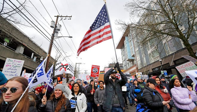 Protesters fill a street during a march in favor of gun control Saturday, March 24, 2018, in Seattle. Students and activists across the country planned events Saturday in conjunction with a Washington march spearheaded by teens from Marjory Stoneman Douglas High School in Parkland, Fla., where over a dozen people were killed in February. (AP Photo/Elaine Thompson)