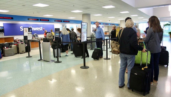 Suspicious package temporarily halts flights though the terminal remained safely open at Pensacola airport.