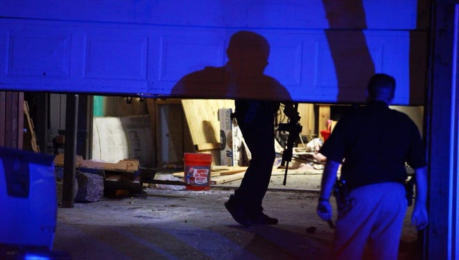 Officers entered a garage of a residence on Mount Vernon Drive and used flashlights to search inside.