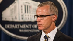 Then-acting FBI director Andrew McCabe waits to speak