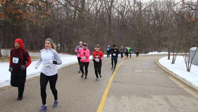 Lori Nickel (in white) partakes in a chilly Flannel 5K run.