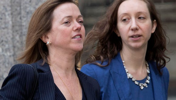 Attorney Joanna Hendon, left, leaves federal court April 13, 2018, in New York.