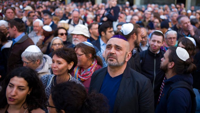People wear Jewish skullcaps, during a demonstration against anti-Semitism in Berlin, Wednesday, April 25, 2018.