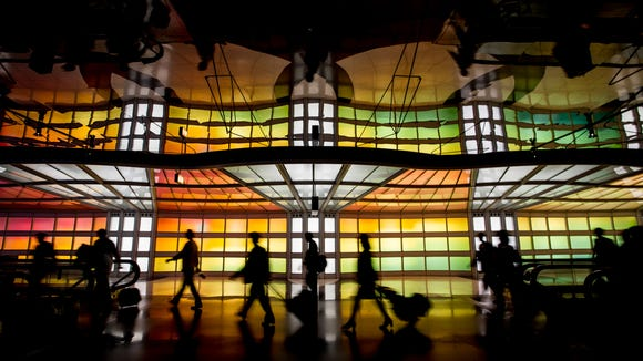 Travellers traverse Chicago O'Hare's unique rainbow