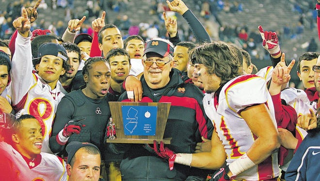 North Bergen head coach Vincent Ascolese and his team celebrate defeating Montclair in December 2011