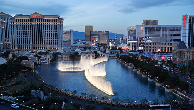 In this April 4, 2017, file photo, the fountains of Bellagio erupt along the Las Vegas Strip in Las Vegas. Tens of thousands of casino workers in Las Vegas whose contracts expire next week were preparing to vote on Tuesday, May 22, 2018, on whether to authorize a strike, a move that could leave more than 30 properties without unionized housekeepers, bartenders, servers and other key employees.
