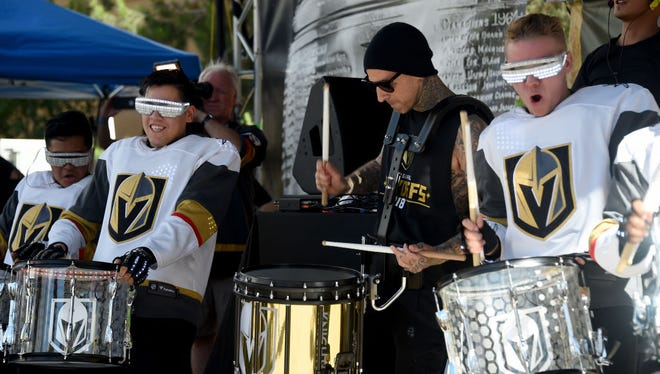 LAS VEGAS, NV - MAY 28:  Blink-182 drummer Travis Barker performs with the Vegas Golden Knights Knight Line Drumbots at Toshiba Plaza prior to Game One of the 2018 NHL Stanley Cup Final between the Vegas Golden Knights and the Washington Capitals on May 28, 2018 in Las Vegas, Nevada.