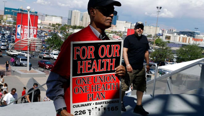 In this May 22, 2018 file photo, Culinary Union members file into a university arena to vote on whether to authorize a strike in Las Vegas.
