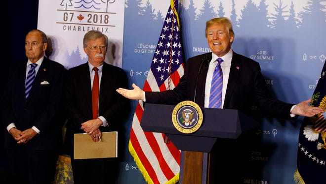 White House chief economic adviser Larry Kudlow, left, and National Security Adviser John Bolton look on as President Donald Trump speaks during a news conference at the G-7 summit, Saturday, June 9, 2018, in La Malbaie, Quebec, Canada.  (AP Photo/Evan Vucci)