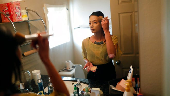 In this April 27, 2018, photo, prostitute Destini Starr applies makeup in her bathroom at the Love Ranch brothel in Crystal, Nev.
