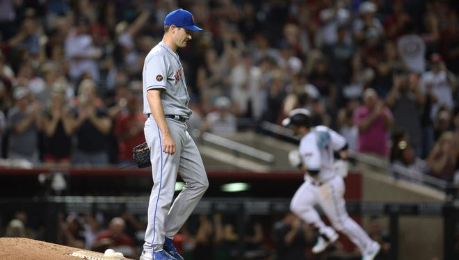 Jun 15, 2018; Phoenix, AZ, USA; New York Mets starting pitcher Seth Lugo (67) reacts after giving up a two run home run to Arizona Diamondbacks third baseman Daniel Descalso (3) during the fifth inning at Chase Field.