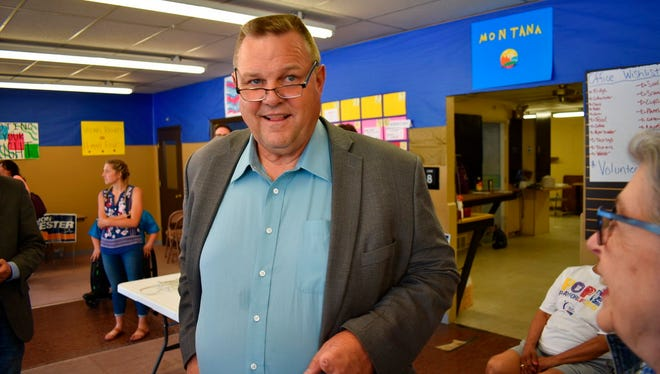 In this Friday, June 8, 2018 photo, U.S. Sen. Jon Tester speaks with a supporter during an event at the Tester campaign headquarters in Billings, Mont. Republicans are hoping to unseat the two-term incumbent in November. (AP Photo/Matthew Brown)