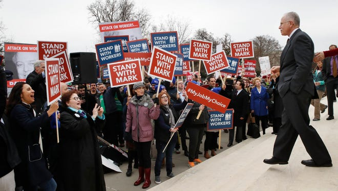 Activists rally in support of Mark Janus at the Supreme Court on Feb. 26, 2018.