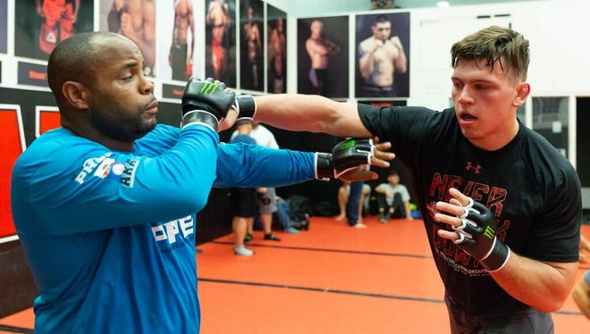 Lex grad Jacob Kasper, a two-time All-American at Duke, spars with UFC light heavyweight champion Daniel Cormier.