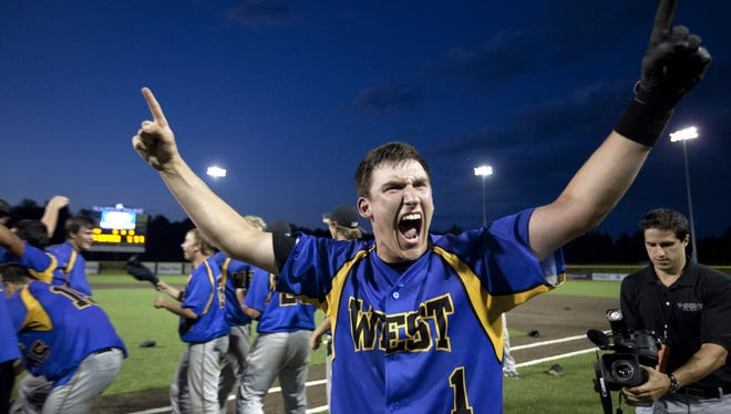 David Tsolak reacts after New Berlin West defeated West Bend West, 11-6, in eight innings in the state championship game.