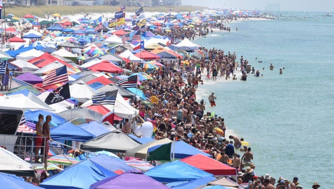Thousands of people crowd Pensacola Beach for the Blue Angels Air Show on Saturday, July 14, 2018.