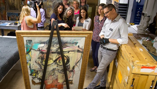 UA staff at the inspection and authentication of the recovered de Kooning painting.