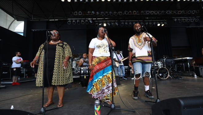 Kari Lyons (from left) Angela Mallett and Keonte Bishop are background vocalists performing at Black Arts Fest MKE.