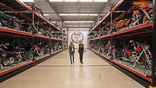 Kristen Jones, exhibit and curatorial lead (left), and Jim Fricke, curatorial director, walk through the Harley-Davidson Museum's  motorcycle storage area, where motorcycles not on exhibit are stored.