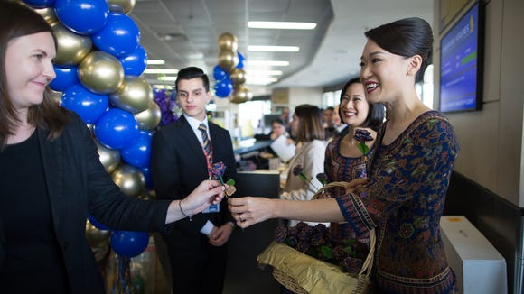 Passengers check in for the world's longest flight,