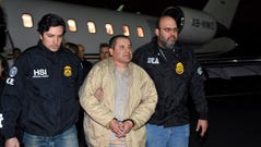 This file photo shows federal authorities escorting