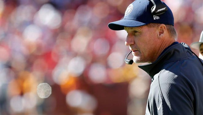 Titans head coach Ken Whisenhunt looks on from the sidelines against the Redskins.