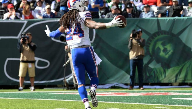 Buffalo Bills cornerback Stephon Gilmore (24) celebrates after intercepting pass from New York Jets quarterback Geno Smith (not pictured) during the first quarter at MetLife Stadium.