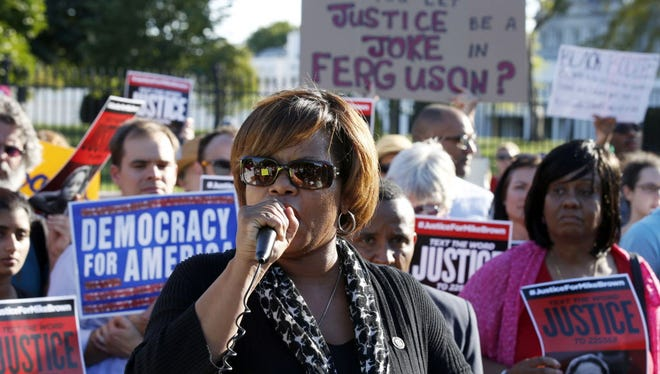 Missouri state Sen. Jamilah Nasheed speaks during a rally for justice for Michael Brown in front of the White House in Washington on Aug. 28.
