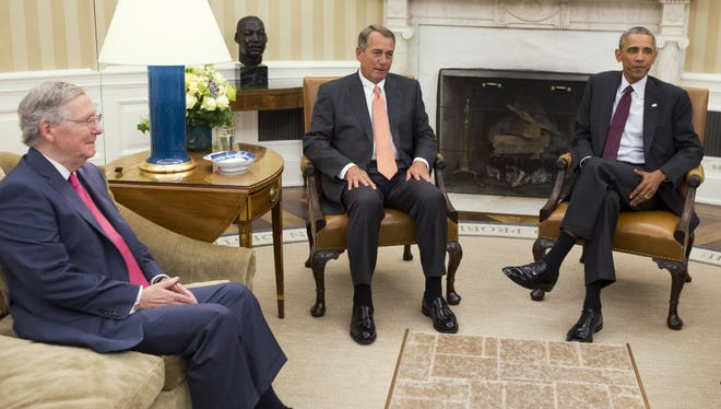 President Obama meets with Senate Minority Leader Mitch McConnell of Kentucky, left, and House Speaker John Boehner of Ohio at the White House in Washington, Tuesday, Sept. 9, 2014. With Republicans gaining control of the Senate  in the midterm elections of Tuesday, Nov. 4, 2014, McConnell will become the Senate majority leader.