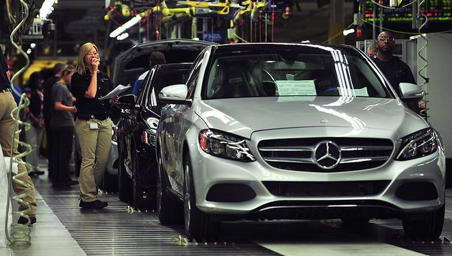 Workers produce C-Class sedans at the Mercedes plant near Tuscaloosa, Ala.