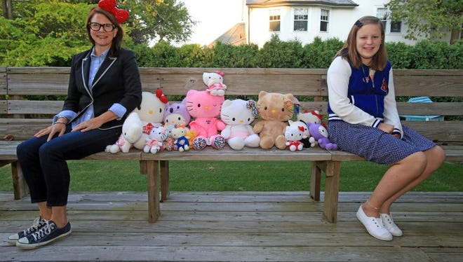 Marie Moss and her daughter Maisie Moss are photographed with their collection of Hello Kitty dolls at their home in Larchmont on Sept. 18, 2014.