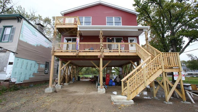 The Cass family home on River Rd. in Stony Point was rebuilt on raised beams after the original home was destroyed by flooding Oct. 23, 2014.