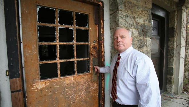 Haverstraw Supervisor Howard Phillips stands at a building at Letchworth Village in Thiells Nov. 13, 2014. The institution closed in 1996 and its builidngs have gone into disrepair. There are discussions to transform the site into Legoland theme park.