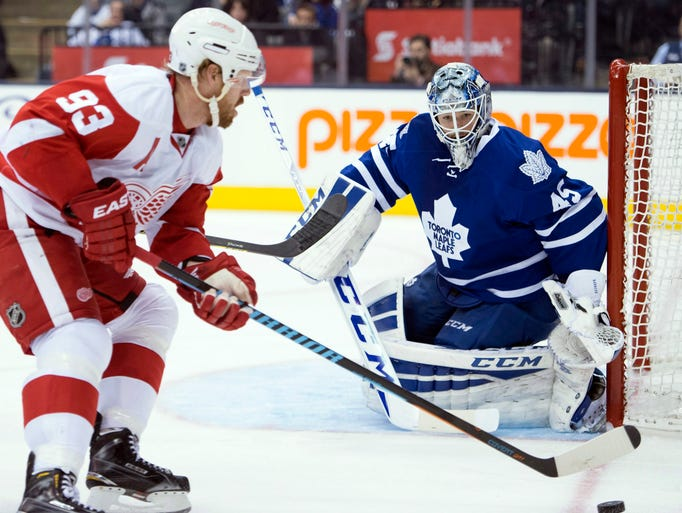 Toronto Maple Leafs goaltender Jonathan Bernier defends