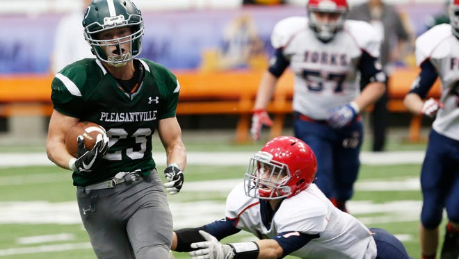 Pleasantville's Charlie McPhee eludes  a tackle in Sunday's 28-14 win over Chenango Forks in the Carrier Dome.