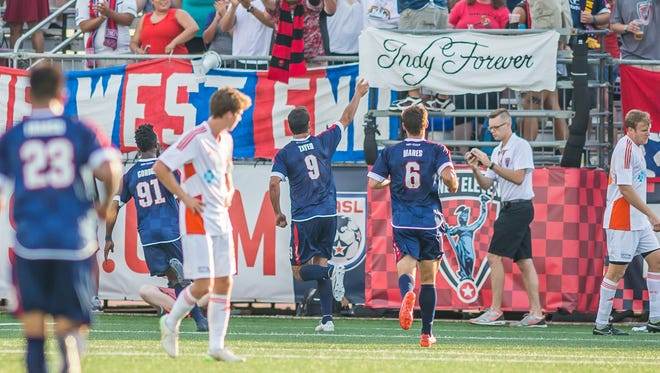 Eamon Zayed celebrates with Indy Eleven teammates and fans after scoring one of his three goals Saturday against Carolina. Zayed's hat trick was instrumental in the Eleven winning the North American Soccer League spring championship.