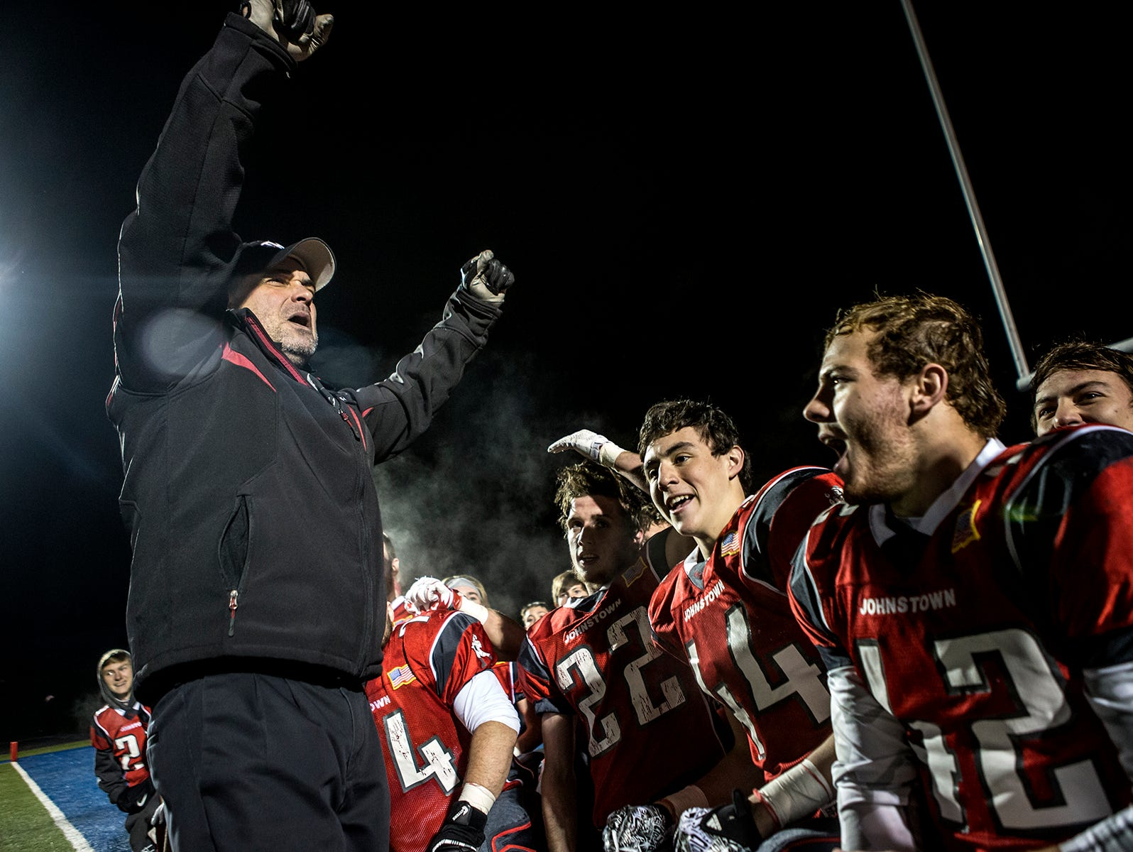Johnstown's head coach Mike Carter celebrates with his team after they won the Division IV regional semifinals Saturday night. The Johnnies took on the St. Clairsville Red Devils winning 42-38. Johnstown will play Steubenville next week.