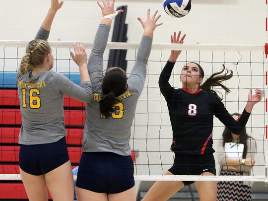 Aubrey Hamilton uses a touch shot to get the ball past the blockers during a game against Kettle Moraine at Arrowhead High School Tuesday, Sept 27, 2016.