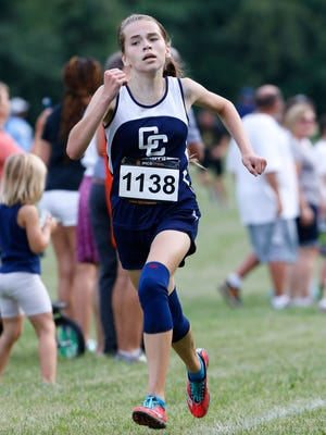 Central Catholic freshman Miriam Walker runs to a first place finish in the City/County cross country meet Tuesday, August 30, 2016, at the Tippecanoe Amphitheater.