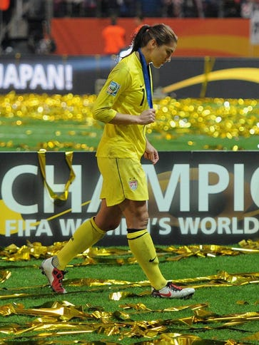 Hope Solo leaves the field after losing to Japan in