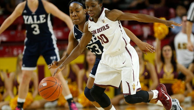 ASU guard Promise Amukamara recovers a tipped pass by Yale guard Tamara Simpson (23) during the first half at Wells Fargo Arena in Tempe Dec. 28, 2014.