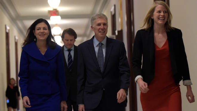 Supreme Court Justice nominee Judge Neil Gorsuch, center, arrives with former New Hampshire Sen. Kelly Ayotte, left, for a meeting with Sen. Shelley Moore Capito, R-W.Va., on Capitol Hill in Washington, Thursday, Feb. 2, 2017.