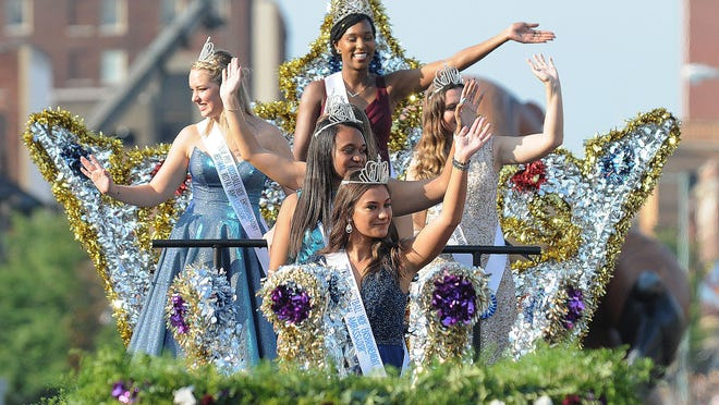 Pro Football Hall of Fame Enshrinement Festival queen Imani Bush and her court ride a float in The Canton Repository Grand Parade, Aug. 4, 2018.