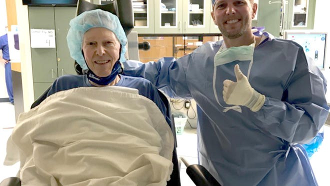 Luther Fry, left, with his son, Eric Fry, following his first of two cataract surgeries in July.