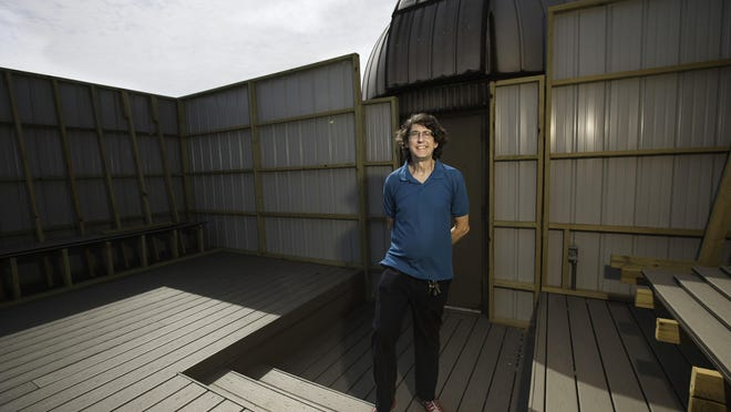 John Martin, associate professor of astronomy/physics at the University of Illinois Springfield, stands on the new deck at the UIS Observatory on Friday.